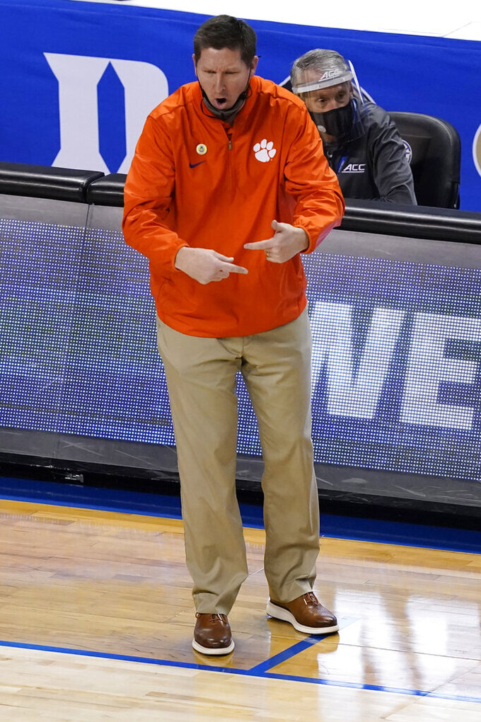 Clemson head coach Brad Brownwell directs his team during the first half of an NCAA college basketball game against Maimi in the second round of the Atlantic Coast Conference tournament in Greensboro, N.C., Wednesday, March 10, 2021. (AP Photo/Gerry Broome)