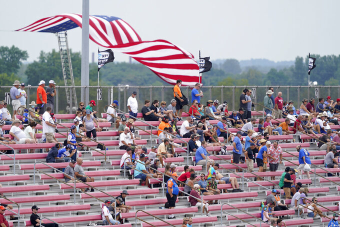 Fans socially distance in the stands due to COVID-19 as they watch the IndyCar auto race at World Wide Technology Raceway on Saturday, Aug. 29, 2020, in Madison, Ill. (AP Photo/Jeff Roberson)