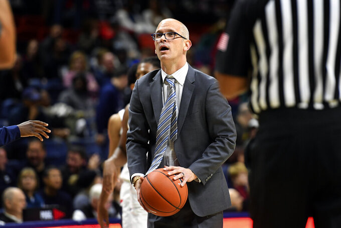 Connecticut head coach Dan Hurley holds the basketball during a timeout in the second half of an NCAA college game against Sacred Heart, Friday, Nov. 8, 2019, in Storrs, Conn. (AP Photo/Stephen Dunn)