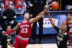 Indiana forward Trayce Jackson-Davis (23) tips out a rebound over Purdue guard Eric Hunter Jr., (2) during the first half of an NCAA college basketball game in West Lafayette, Ind., Saturday, March 6, 2021. (AP Photo/Michael Conroy)