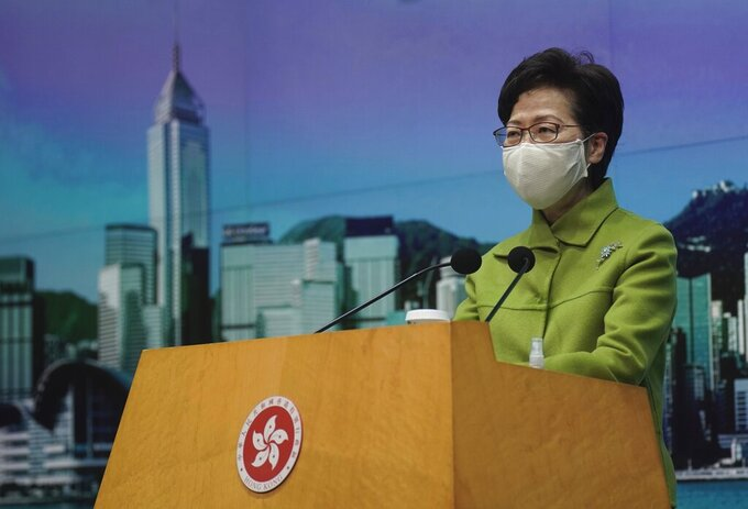 """FILE - In this Jan. 26, 2021, file photo, Hong Kong Chief Executive Carrie Lam listens to reporters' questions during a press conference in Hong Kong. Hong Kong leader Carrie Lam said Tuesday, Feb. 23, that it was """"crystal clear"""" that electoral reform is necessary, a day after a top Beijing official signaled major changes would be coming to ensure the semi-autonomous city is run by """"patriots. (AP Photo/Vincent Yu, File)"""