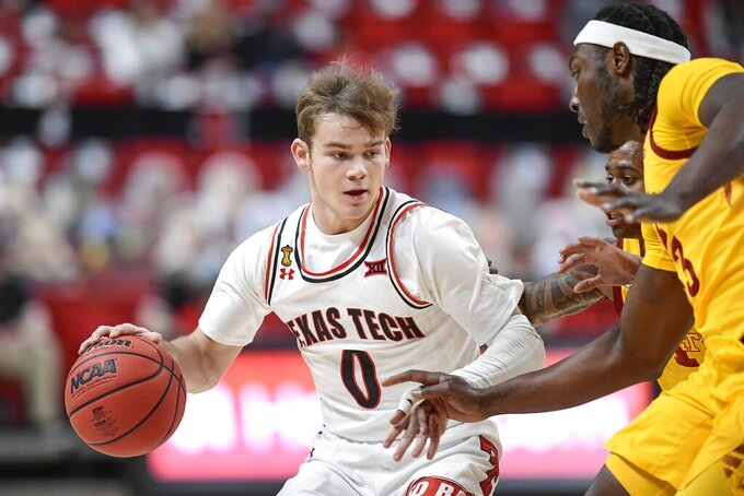 Texas Tech's Mac McClung (0) is defended by Iowa State's Tre Jackson (3) during the first half of an NCAA college basketball game in Lubbock, Texas, Thursday, March 4, 2021. (AP Photo/Justin Rex)