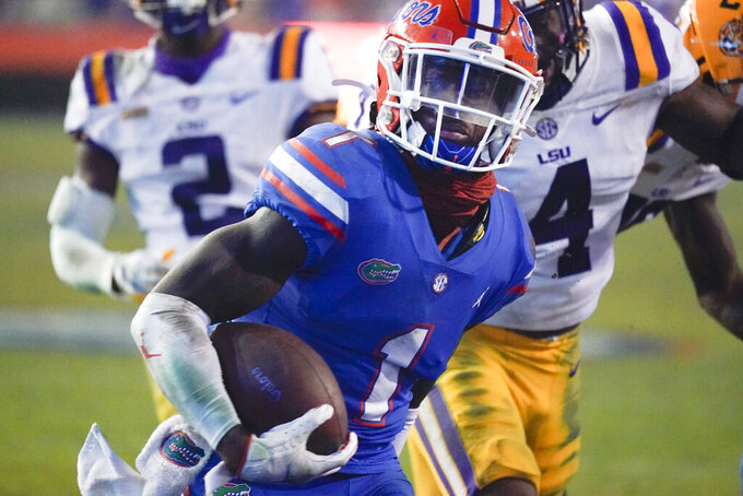 Florida wide receiver Kadarius Toney (1) scores a touchdown during the second half of the team's NCAA college football game against LSU, Saturday, Dec. 12, 2020, in Gainesville, Fla. (AP Photo/John Raoux)