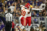 Kansas City Chiefs wide receiver Tyreek Hill (10) celebrates with teammate Demarcus Robinson after Robinson scored a touchdown in the first half of an NFL football game against the Baltimore Ravens, Sunday, Sept. 19, 2021, in Baltimore. (AP Photo/Julio Cortez)
