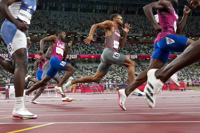Andre De Grasse, center, of Canada, wins the gold medal in the men's 200-meter final at the 2020 Summer Olympics, Wednesday, Aug. 4, 2021, in Tokyo. (AP Photo/Martin Meissner)