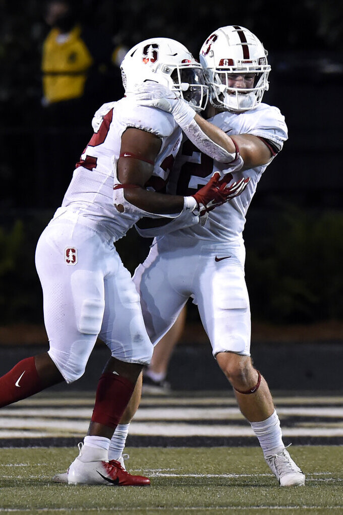 Stanford's Casey Filkins (2) celebrates with running back E.J. Smith (22) after Smith scored a touchdown against Vanderbilt during the second half of an NCAA college football game Saturday, Sept. 18, 2021, in Nashville, Tenn. (AP Photo/Mark Zaleski)