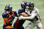 Denver Broncos wide receiver K.J. Hamler (13) runs against Atlanta Falcons cornerback Blidi Wreh-Wilson (33)during the first half of an NFL football game, Sunday, Nov. 8, 2020, in Atlanta. (AP Photo/Brynn Anderson)