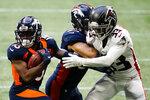 Denver Broncos wide receiver K.J. Hamler (13) runs against Atlanta Falcons cornerback Blidi Wreh-Wilson (33)during the first half of an NFL football game, Sunday, Nov. 8, 2020, in Atlanta. (AP Photo/Brynn Anderson)