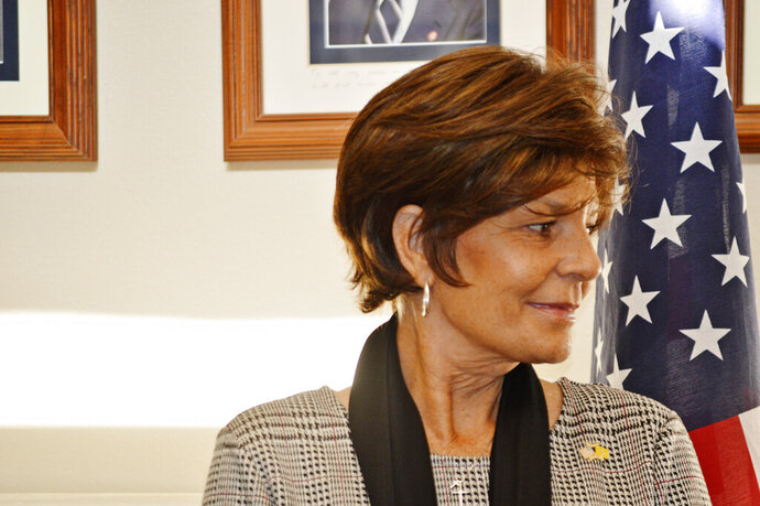 FILE - In this Nov. 4, 2019, file photo, Republican U.S. House hopeful Yvette Herrell of New Mexico waits for a news conference in Albuquerque, N.M., about a GOP challenge to the way the state is counting absentee ballots. Three Republican hopefuls seeking to challenge Democratic U.S. Rep. Xochitl Torres Small for a key southern New Mexico seat. (AP Photo/Russell Contreras, File)