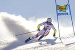 Switzerland's Marco Odermatt speeds down the course during an alpine ski, men's World Cup giant slalom in Soelden, Austria, Sunday, Oct. 18, 2020. (AP Photo/Giovanni Auletta)
