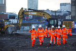 """Britain's Prime Minister Boris Johnson, 2nd left, walks with apprentices during a tour of the Curzon Street railway station, where the new High Speed 2 (HS2) rail project is under construction, in Birmingham, England, Tuesday Feb. 11, 2020.  Boris Johnson said his Cabinet had given the """"green light"""" to the high-speed rail line that will link London with central and northern England, despite the huge cost prediction and opposition from environmentalists. (Eddie Keogh/Pool via AP)"""