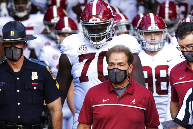 FILE - In this Sept. 26, 2020, file photo, Alabama coach Nick Saban leads his team to the field before an NCAA college football game against Missouri in Columbia, Mo. Alabama is No. 1 in The Associated Press college football poll for the first time this year, extending its record of consecutive seasons with at least one week on top of the rankings to 13. (AP Photo/L.G. Patterson, File)