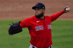 Boston Red Sox starting pitcher Eduardo Rodríguez (57) works against the Minnesota Twins in the second inning of a spring training baseball game, Thursday, March 11, 2021, in Fort Myers, Fla.. (AP Photo/John Bazemore)