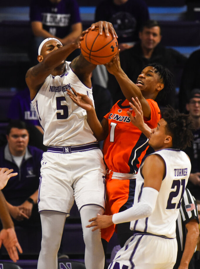 Northwestern center Dererk Pardon (5) and forward A.J. Turner (21) fight for a rebound against Illinois guard Trent Frazier (1) during the first half of an NCAA college basketball game on Sunday, Jan. 6, 2019, in Evanston, Ill. (AP Photo/Matt Marton)