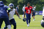 Seattle Seahawks quarterback Russell Wilson (3) walks off the field after NFL football training camp, Wednesday, Aug. 12, 2020, in Renton, Wash. (AP Photo/Ted S. Warren)
