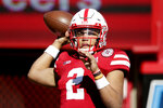Nebraska quarterback Adrian Martinez (2) warms up before an NCAA college football game against Minnesota in Lincoln, Neb., Saturday, Oct. 20, 2018. (AP Photo/Nati Harnik)