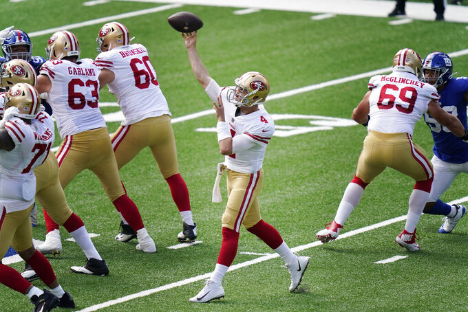 San Francisco 49ers quarterback Nick Mullens throws during the first half of an NFL football game against the New York Giants, Sunday, Sept. 27, 2020, in East Rutherford, N.J. (AP Photo/Corey Sipkin)