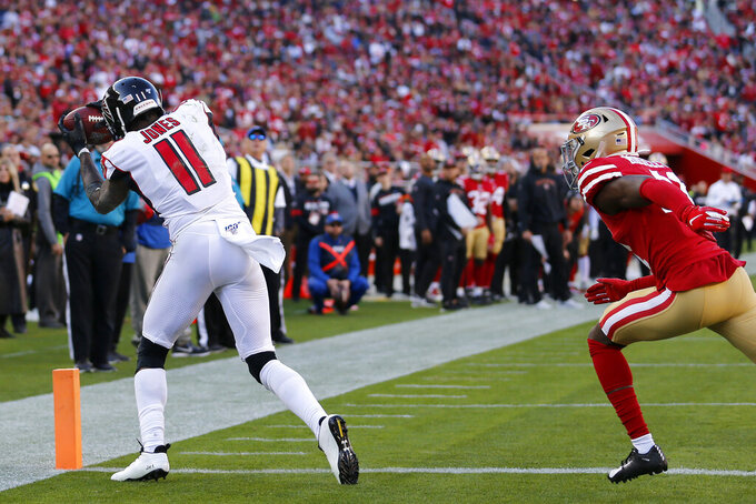 Atlanta Falcons wide receiver Julio Jones (11) catches a touchdown pass in front of San Francisco 49ers defensive back Emmanuel Moseley during the first half of an NFL football game in Santa Clara, Calif., Sunday, Dec. 15, 2019. (AP Photo/Josie Lepe)