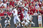 South Carolina's Shi Smith, center, goes up for a touchdown pass while defended by Alabama's Jordan Battle, left, and Shyheim Carter during the first half of an NCAA college football game Saturday, Sept. 14, 2019, in Columbia, S.C. (AP Photo/Richard Shiro)