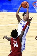 Kentucky's Jacob Toppin shoots as Alabama's Keon Ellis (14) defends during the second half of an NCAA college basketball game in Lexington, Ky., Tuesday, Jan. 12, 2021. (AP Photo/James Crisp)