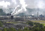 FILE- This file photo from July 14, 2010 shows smoke pouring from the United States Steel Corp.'s Clairton Coke Works in Clairton, Pa. A fire at U.S. Steel's massive coke plant outside Pittsburgh knocked a key pollution control system offline Monday, June 17, 2019. It triggered a health warning as officials monitored the air around the plant for signs of a release of toxic sulfur dioxide. It was the second fire since December at the coke works, the largest facility of its kind in the United States. The plant turns coal into coke, one of the raw materials of steel. (AP Photo/Keith Srakocic, File)