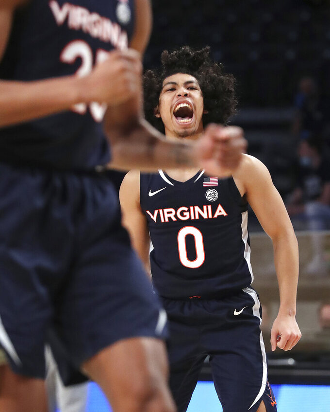 Virginia guard Kihei Clark reacts to hitting a 3-pointer in the final minutes of the team's 57-49 victory over Georgia Tech in an NCAA college basketball game Wednesday, Feb. 10, 2021, in Atlanta. (Curtis Compton/Atlanta Journal-Constitution via AP)