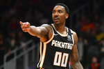 Atlanta Hawks guard Jeff Teague reacts toward a referee during the first half of an NBA basketball game against the Detroit Pistons, Saturday, Jan. 18, 2020, in Atlanta. (AP Photo/John Amis)