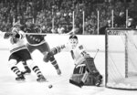 FILE - In this April 15, 1972, file photo, New York Rangers left winger Pete Stemkowski (21) puts his arm around the neck of Chicago Blackhawks defenseman Keith Magnuson (3) after firing a shot on Blackhawks goalie Tony Esposito (35) during the opening game of an NHL hockey Stanley Cup second-round playoff series in Chicago. Esposito, a Hall of Fame goaltender who played almost his entire 16-year career with the Blackhawks, has died following a brief battle with pancreatic cancer, the team announced Tuesday, Aug. 10, 2021. He was 78. (AP Photo/Fred Jewell, File)
