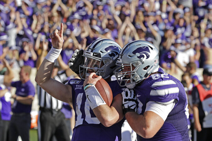 Kansas State quarterback Skylar Thompson (10) celebrates with offensive lineman Tyler Mitchell (62) after running the ball to score a touchdown during the second half of an NCAA college football game against TCU Saturday, Oct. 19, 2019, in Manhattan, Kan. Kansas State won 24-17. (AP Photo/Charlie Riedel)