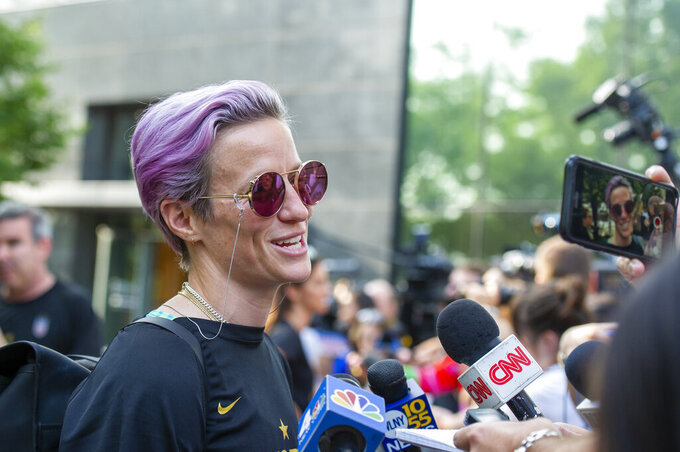 United States women's soccer team member Megan Rapinoe speaks to the media upon her arrival at a hotel Monday, July 8, 2019, in New York. The city will honor the team with a parade Wednesday for their fourth Women's World Cup victory. (AP Photo/Corey Sipkin)