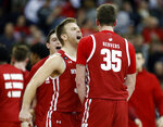 Wisconsin guard Brad Davison, left, celebrates with teammate forward Nate Reuvers during the final seconds of the second half of an NCAA college basketball game against Ohio State in Columbus, Ohio, Friday, Jan. 3, 2020. (AP Photo/Paul Vernon)