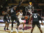 Virginia Tech's Nickeil Alexander-Walker (4) looks to pass the ball while guarded by Miami's Zach Johnson (5), Ebuka Izundu (15) and Chris Lykes (0) during the first half of NCAA college basketball game in Blacksburg, Va., Friday, March 8, 2019. (Matt Gentry/The Roanoke Times via AP)