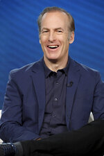 """FILE - In this Thursday, Jan. 16, 2020, file photo, Bob Odenkirk speaks at the AMC's """"Better Call Saul,"""" panel during the AMC Networks TCA 2020 Winter Press Tour at the Langham Huntington, in Pasadena, Calif. Odenkirk is back shooting """"Better Call Saul,"""" six weeks after having a heart attack. Odenkirk on Wednesday, Sept. 8, 2021, tweeted a photo of himself getting made up to play title character Saul Goodman in the AMC series, indicating that shooting had resumed on its sixth and final season. (Photo by Willy Sanjuan/Invision/AP, File)"""