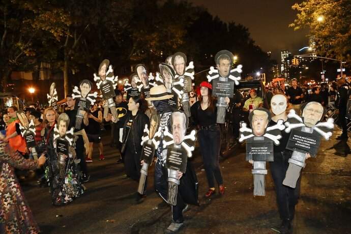 Revelers march during the Greenwich Village Halloween Parade, Thursday, Oct. 31, 2019, in New York. (AP Photo/Frank Franklin II)