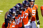 Denver Broncos quarterback Drew Lock, left, motions to his sideline as his teammates look on during the first half of an NFL football game again the Los Angeles Chargers, Sunday, Nov. 1, 2020, in Denver. (AP Photo/Jack Dempsey)