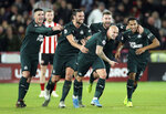 Newcastle United's Jonjo Shelvey, front centre, celebrates with teammates after scoring his side's second goal of the game against Sheffield United, during their English Premier League soccer match at Bramall Lane in Sheffield, England, Thursday Dec. 5, 2019. (Danny Lawson/PA via AP)