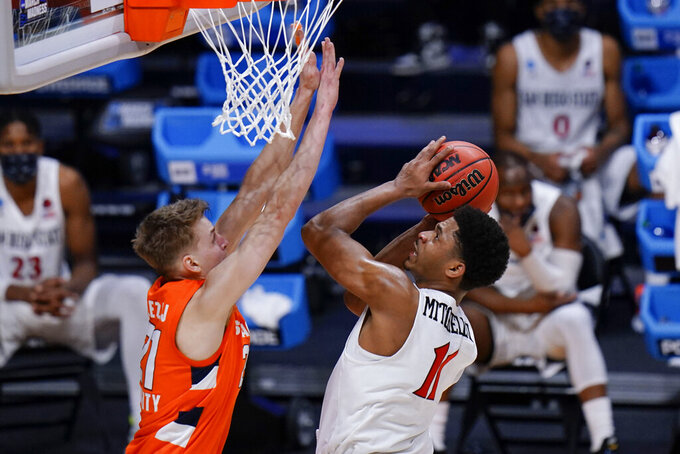 San Diego State forward Matt Mitchell (11) shoots over Syracuse forward Marek Dolezaj (21) during the second half of a college basketball game in the first round of the NCAA men's tournament at Hinkle Fieldhouse in Indianapolis, Friday, March 19, 2021. Syracuse won 78-62. (AP Photo/AJ Mast)