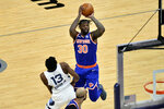 New York Knicks forward Julius Randle (30) shoots against Memphis Grizzlies forward Jaren Jackson Jr. (13) in the second half of an NBA basketball game Monday, May 3, 2021, in Memphis, Tenn. (AP Photo/Brandon Dill)