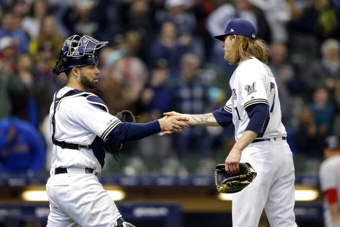 Milwaukee Brewers' Josh Hader, right, shakes hands with Manny Pina after recording a save during the ninth inning of a baseball game against the Washington Nationals, Wednesday, May 8, 2019, in Milwaukee. (AP Photo/Aaron Gash)
