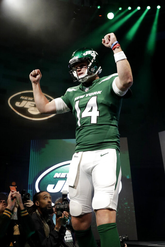 "New York Jets quarterback Sam Darnold models the NFL football team's new ""Gotham green"" uniforms Thursday, April 4, 2019, in New York. (AP Photo/Julio Cortez)"