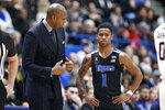 "Memphis head coach Anfernee ""Penny"" Hardaway, left, talks with Tyler Harris, right, in the second half of an NCAA college basketball game, against Connecticut, Sunday, Feb. 16, 2020, in Hartford, Conn. (AP Photo/Jessica Hill)"