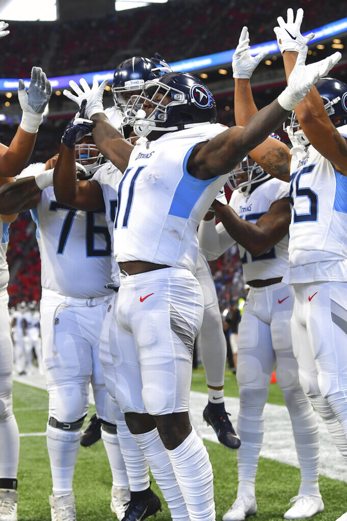Tennessee Titans wide receiver A.J. Brown (11) scores acelebrates his touchdown against the Atlanta Falcons during the first half of an NFL football game, Sunday, Sept. 29, 2019, in Atlanta. (AP Photo/John Amis)