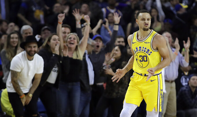 FILE - Golden State Warriors' Stephen Curry celebrates a score against the Sacramento Kings during the second half of an NBA basketball game in Oakland, Calif., in this Thursday, Feb. 21, 2019, file photo. While Golden State is still dealing with the devastating news Splash Brother Klay Thompson will miss another season because of a torn right Achilles tendon that required surgery, everybody is eager for a fresh start. Especially Curry, who played only five games because of a broken left hand. (AP Photo/Ben Margot, File)