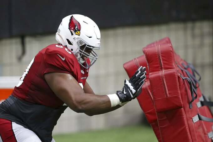 Arizona Cardinals offensive guard Tariq Cole goes through a blocking drill during NFL football training camp Wednesday, July 31, 2019, in Glendale, Ariz. (AP Photo/Ross D. Franklin)