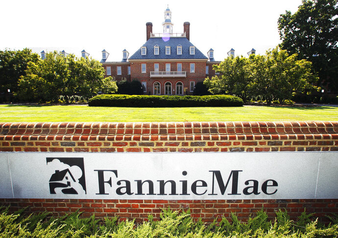 FILE - This Aug. 8, 2011, file photo shows the Fannie Mae headquarters in Washington. Fannie Mae said Wednesday, Feb. 14, 2018, its net worth sank to a negative $3.7 billion after it had to