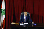 Parliament Speaker Nabih Berri speaks during a parliament session to confirm Lebanon's new government at a Beirut theater known as the UNESCO palace so that parliament members could observe social distancing measures imposed over the coronavirus pandemic, Lebanon, Monday, Sept. 20, 2021. A power outage and a broken generator briefly delayed the start of the parliament session for some 40 minutes before electricity came back on. (AP Photo/Bilal Hussein)