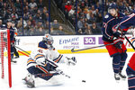 Edmonton Oilers' Mike Smith, left, makes a save against Columbus Blue Jackets' Josh Anderson during the second period of an NHL hockey game Wednesday, Oct. 30, 2019, in Columbus, Ohio. (AP Photo/Jay LaPrete)