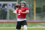 New York Jets quarterback Zach Wilson drops back for a pass during NFL football practice, Wednesday, June 2, 2021, in Florham Park, N.J. (AP Photo/Kathy Willens)