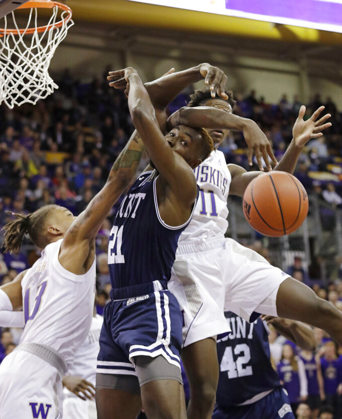 A loose ball gets past Mount St. Mary's Collin Nnamene (21) and Washington's Hameir Wright (13) and Nahziah Carter (11) during the first half of an NCAA college basketball game Tuesday, Nov. 12, 2019, in Seattle. (AP Photo/Elaine Thompson)