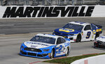 Brad Keselowski (2) leads Chase Elliott (9) as they drive into Turn 4 during a NASCAR Cup Series auto race at Martinsville Speedway in Martinsville, Va., Sunday, March 24, 2019. (AP Photo/Steve Helber)